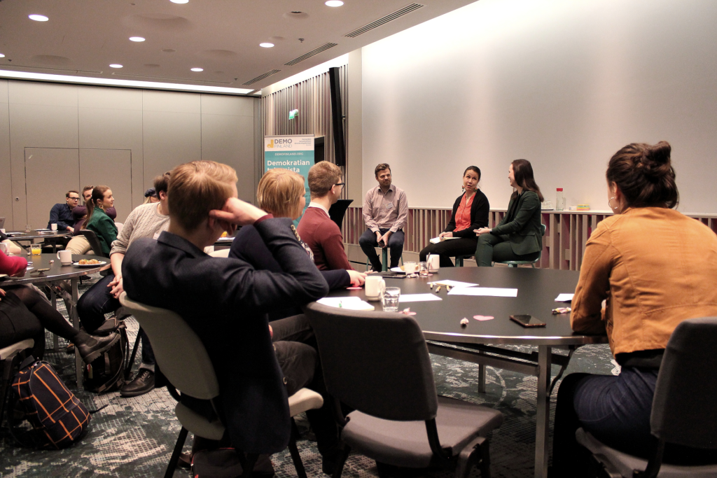 Group of people listening to a panel discussion